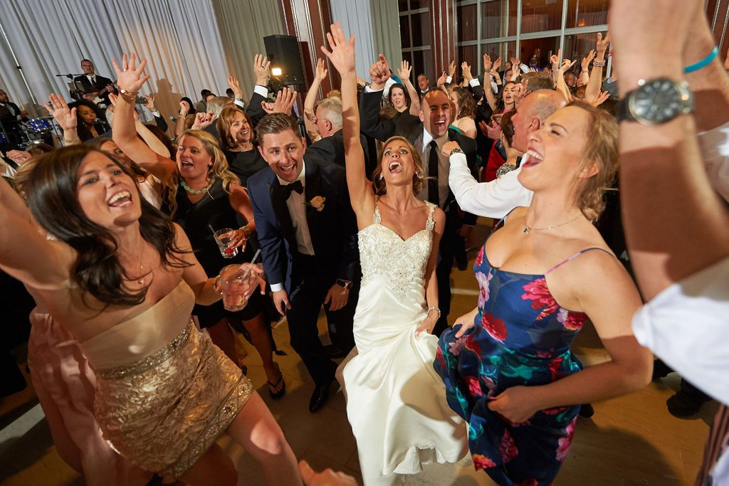 Bride and Groom, Guests Dancing at an NYC wedding by Around Town Entertainment