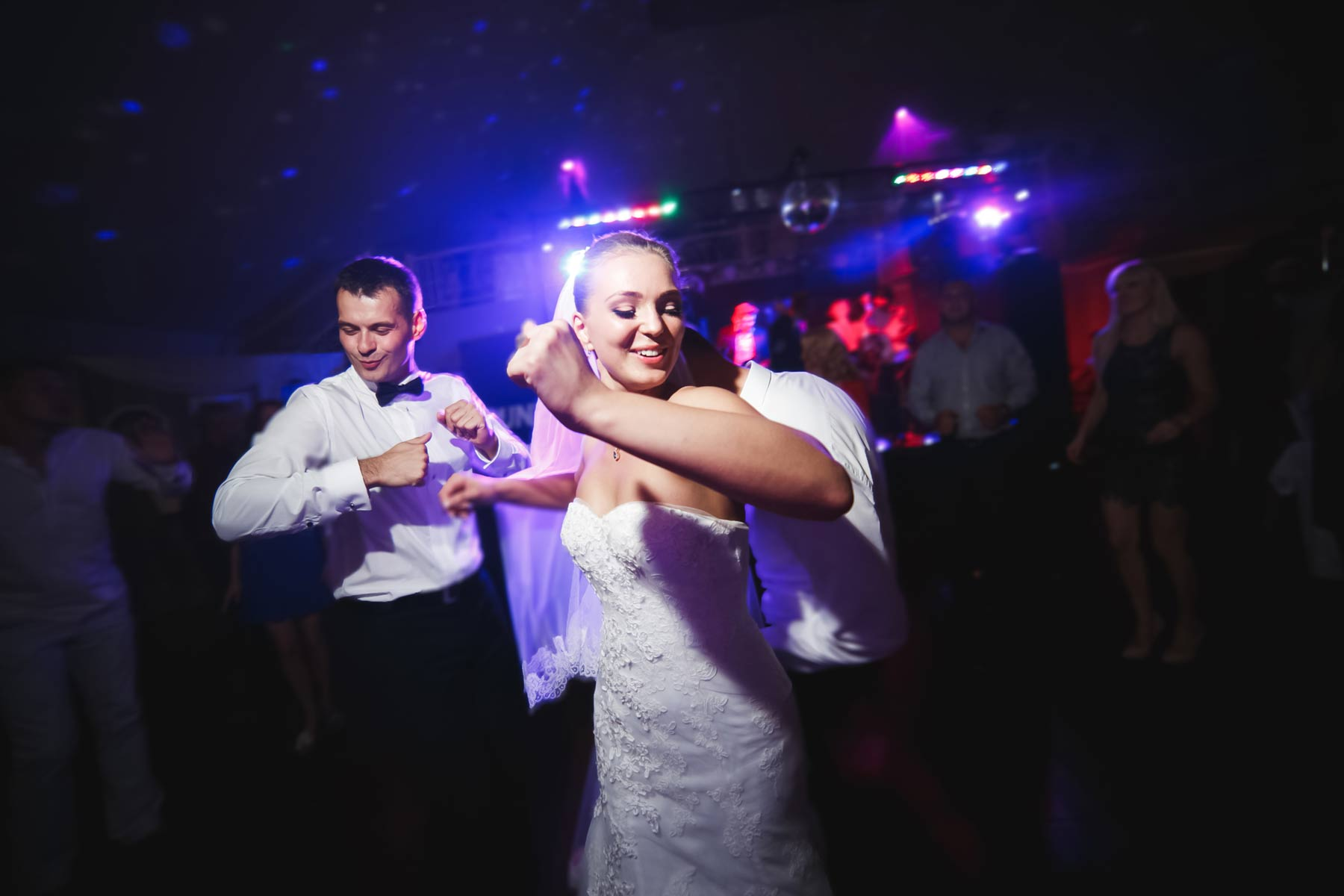 Bride and Groom grooving on the dance floor with guests
