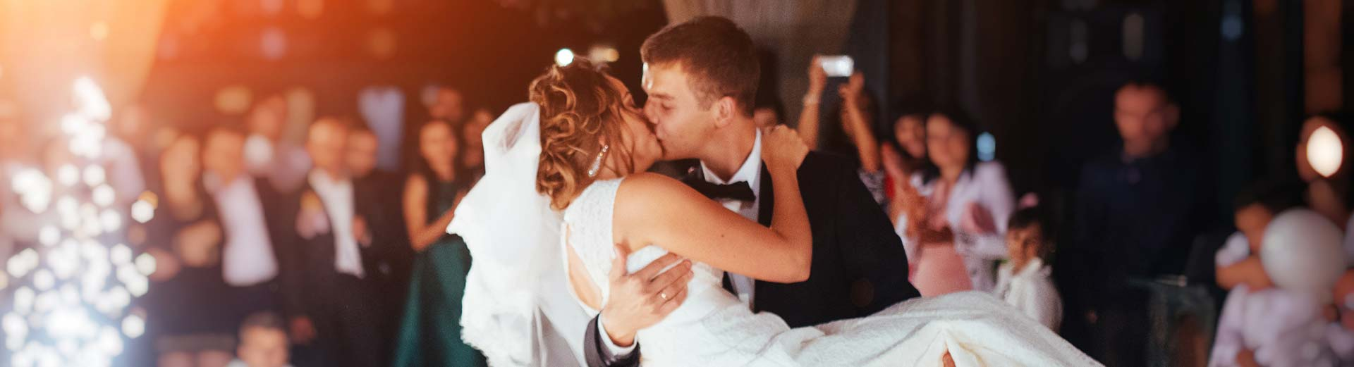 Bride and Groom share a passionate kiss on the dance floor